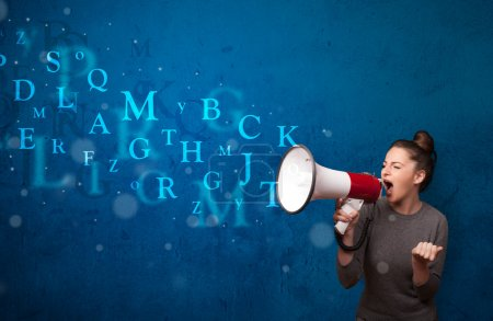 Photo for Young girl shouting into megaphone and abstract text come out - Royalty Free Image