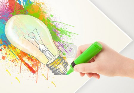 Photo for Hand drawing on a plain paper a colorful splatter lightbulb - Royalty Free Image