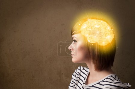 Photo for Young girl thinking with glowing brain illustration on grungy background - Royalty Free Image