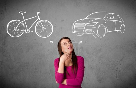 Woman making a choice between bicycle and car