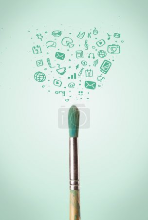 Photo for Paintbrush close-up with sketchy social media icons - Royalty Free Image