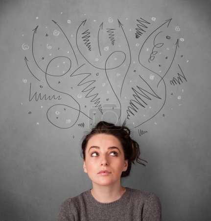 Photo for Pretty young woman deciding with sketched arrows over her head - Royalty Free Image