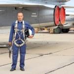 Military pilot in a helmet near the aircraft...