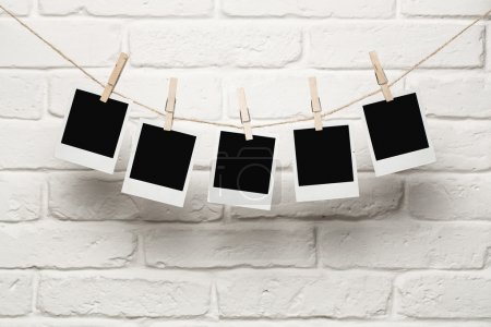 Blank photos hanging on a clothes line