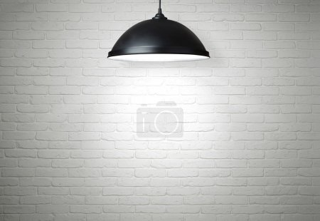 Photo for White brick wall illuminated by the lamp with copy space - Royalty Free Image