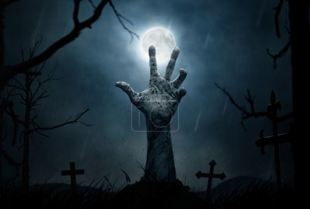 Halloween, zombie's hand coming out from the soil