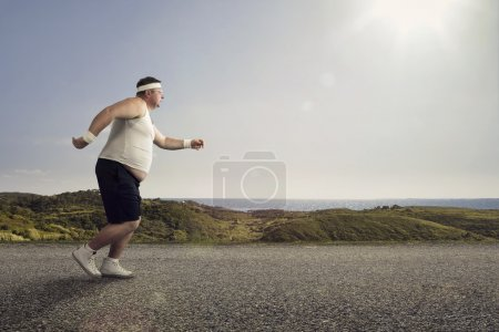 Photo for Funny overweight man jogging on the road - Royalty Free Image