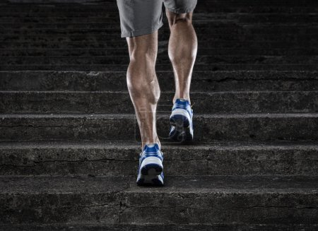 Photo for Close up of young man running up the stairs - Royalty Free Image