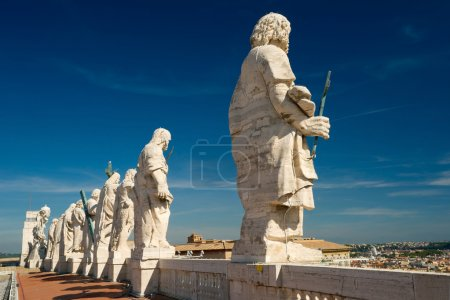Statues on the roof of St. Peter`s basilica, Vatican