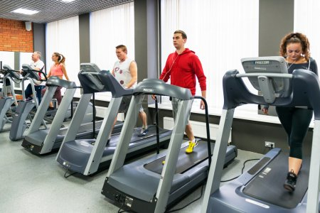 Young people doing exercises in the gym