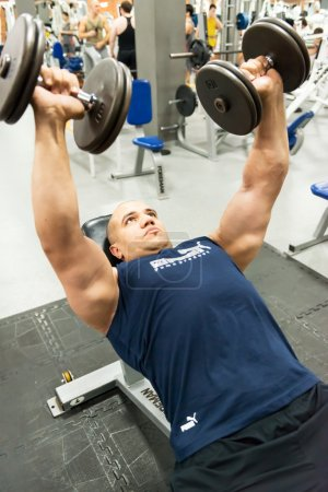 Man engaged in physical exercise in the gym
