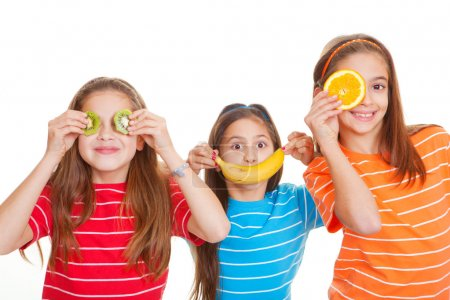 Photo for Kids eating healthy fresh fruit diet concept - Royalty Free Image