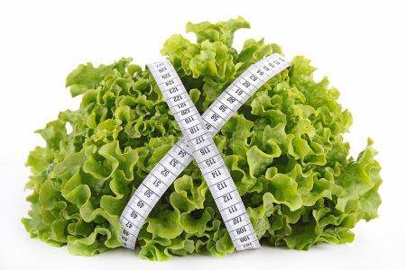 Photo pour Salade verte et ruban adhésif - image libre de droit