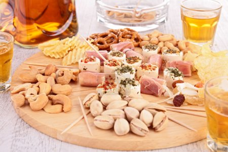 Photo for Appetizer for beer on wooden plate - Royalty Free Image