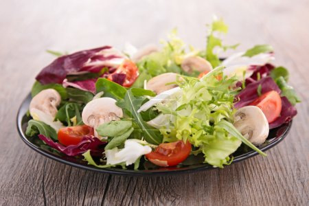 Salad with mushroom and tomato