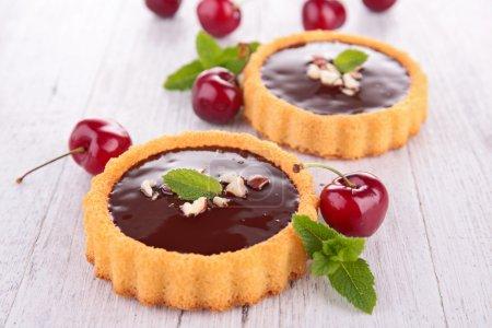 Chocolate tarts and cherries