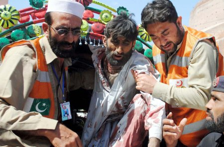 Victims of bomb explosion at the Jalozai camp in Nowshera being shifted at Lady Reading Hospital for treatment