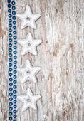 Yıldız şekilleri ve çelenk Noel arka plan