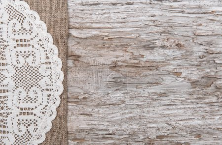 Photo for Old wood bordered by lacy cloth and burlap background - Royalty Free Image