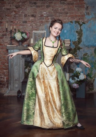Smiling beautiful woman in medieval dress dance