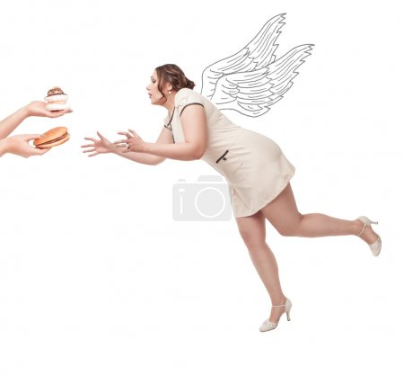 Beautiful plus size woman flying for junk food