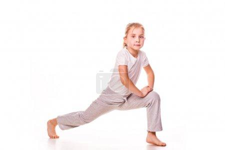 Beautiful girl gymnast exercising, stretching