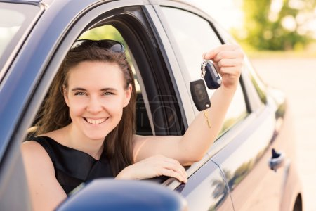 Beautiful businesswoman driving in the car