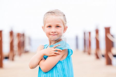 Photo for Portrait of beautiful little girl posing on the pier at the seaside - Royalty Free Image