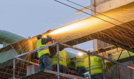 Steel workers prepare for the transfer of the steel bridge