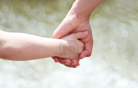 Photo for Hands of mother and child - Royalty Free Image