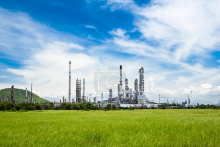 Photo for Oil refinery plant against blue sky - Royalty Free Image
