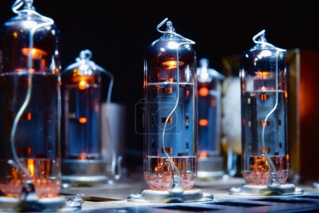 Photo for Glowing vacuum electron tubes of vintage guitar amplifier - Royalty Free Image