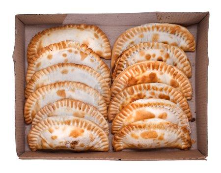 Photo for Argentinian empanada, meat pie on white background. Dozen. - Royalty Free Image