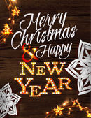 Christmas garland poster with lettering Merry Christmas and happy new year in a retro style with decorations in garlands gloving and paper snowflakes on wood background