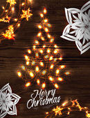 Christmas tree garland poster with lettering Merry Christmas and happy new year in a retro style with decorations in garlands gloving and paper snowflakes on wood background