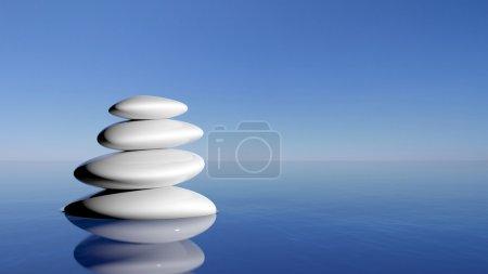 Photo pour Pierres zen dans l'eau bleue - image libre de droit