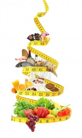 Photo for Diet food pyramid with measure tape - Royalty Free Image