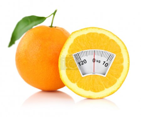 Weight scale on an orange, diet concept