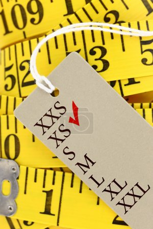 Measuring tape closeup with xs size tag