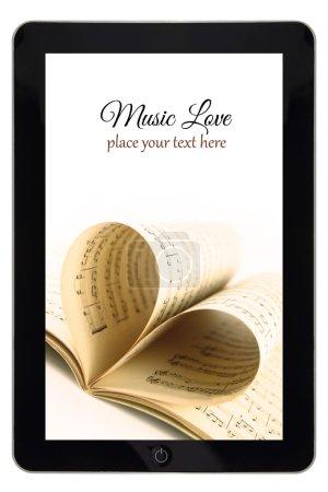 Photo pour Musique en ligne, tablette avec notes et coeur blanc - image libre de droit