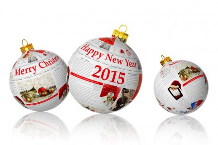 Christmas articles on newspaper balls isolated on white background