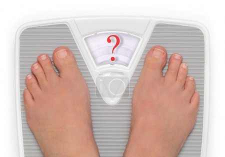 Female feet on bathroom scale with question mark symbol