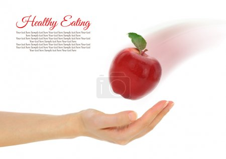 Female hand with fresh red apple isolated on white