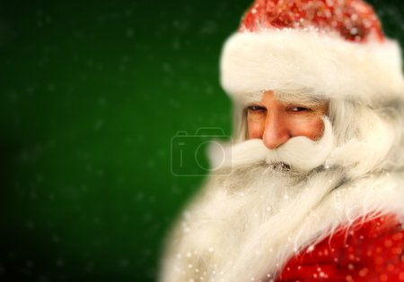Photo for Santa Claus portrait smiling in snowfall - Royalty Free Image