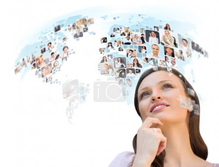 Young successful woman looking at worldmap with profile photos