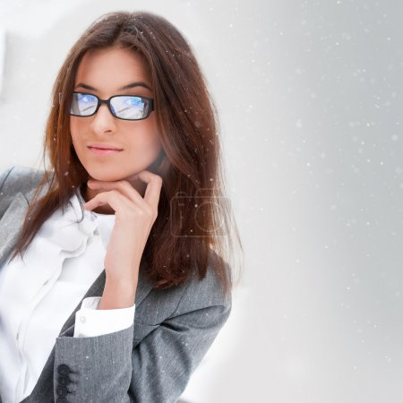 Beautiful business woman wearing glasses smiling and looking at camera