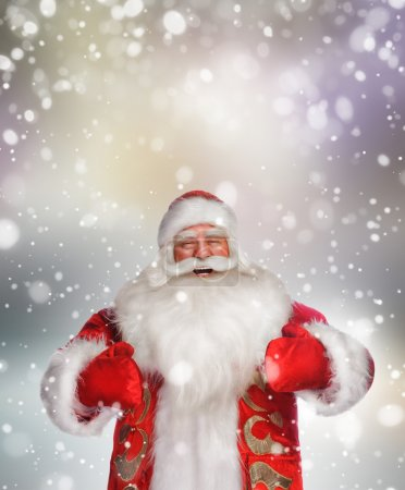 Photo for Laughing happy Santa Claus over snowflake background - Royalty Free Image
