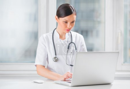 Photo for Portrait of a female doctor using her laptop computer at clinic - Royalty Free Image