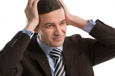 Business man holding his head