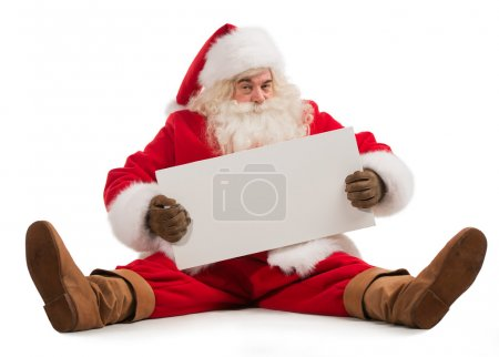 Photo for Santa Claus holding Banner with Space for Your Text Isolated On White Background. Sitting full length portrait - Royalty Free Image